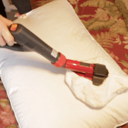 steam cleaner on pillows